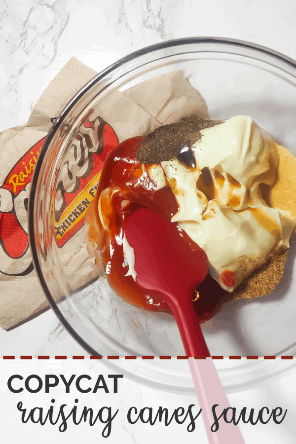 A pin image of the ingredients in Raising Cane's sauce in a glass bowl with a red spatula.