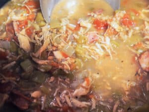 A pot of gumbo cooking.