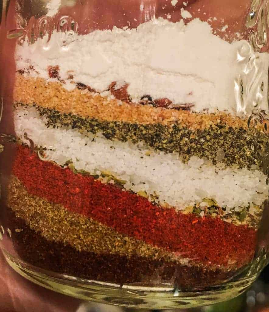 A jar of layered taco seasoning.