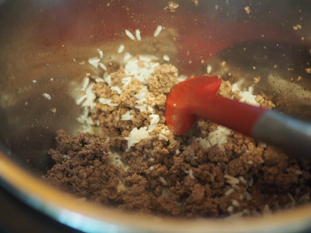 Ground beef and rice cooking in an Instant Pot.