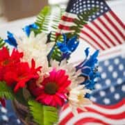 Red, white, and blue flowers and a small American flag.