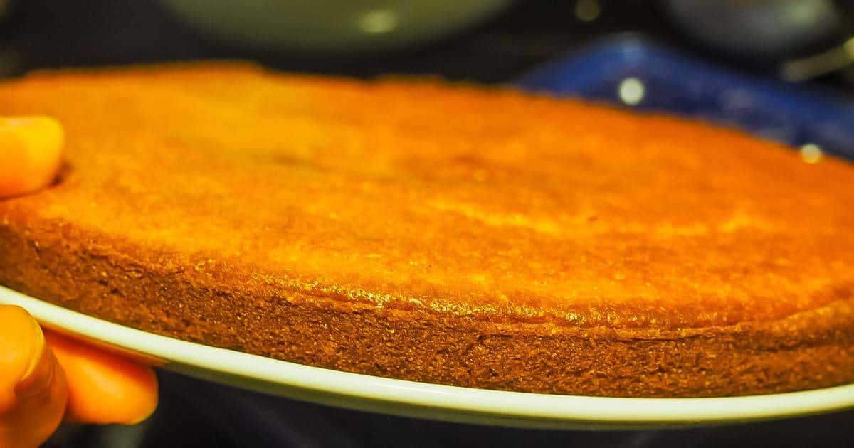 The side view of a plate of cornbread that did not rise.