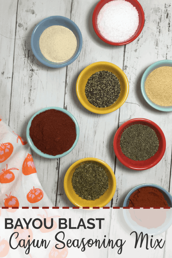 A prep picture of small colorful bowls filled with the ingredients of Bayou Blast Cajun Seasoning Mix.