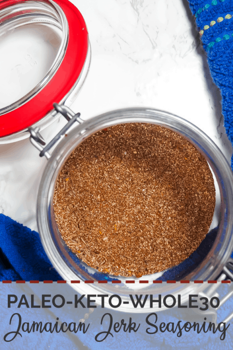A pin image of a small jar with the mixed ingredients of Jamaican Jerk Seasoning and a blue dish cloth.