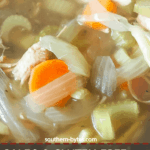 A pin image of a zoomed in bowl of paleo chicken noodle soup.