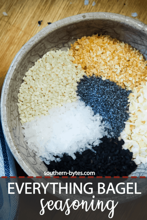 A pin image of a bowl of the unmixed ingredients in everything bagel seasoning.