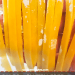 A pin image of a hand draped with homemade paleo fettuccine.