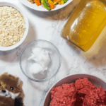 A pin image of homemade dog food ingredients.
