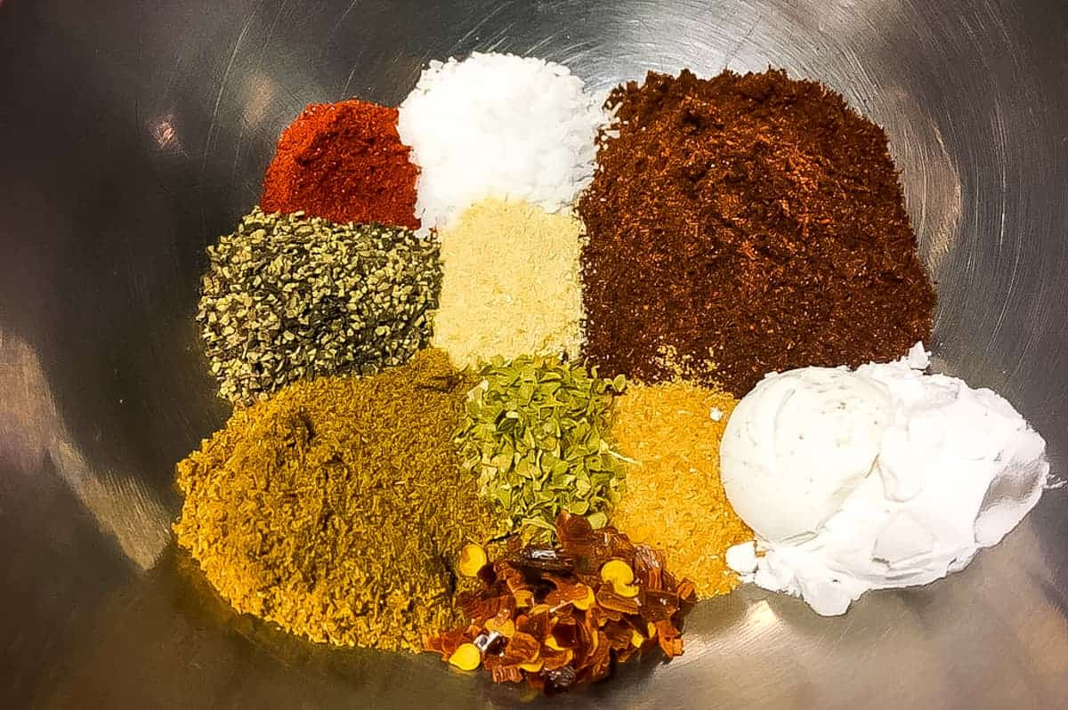 The ingredients in taco seasoning in a bowl, unmixed.