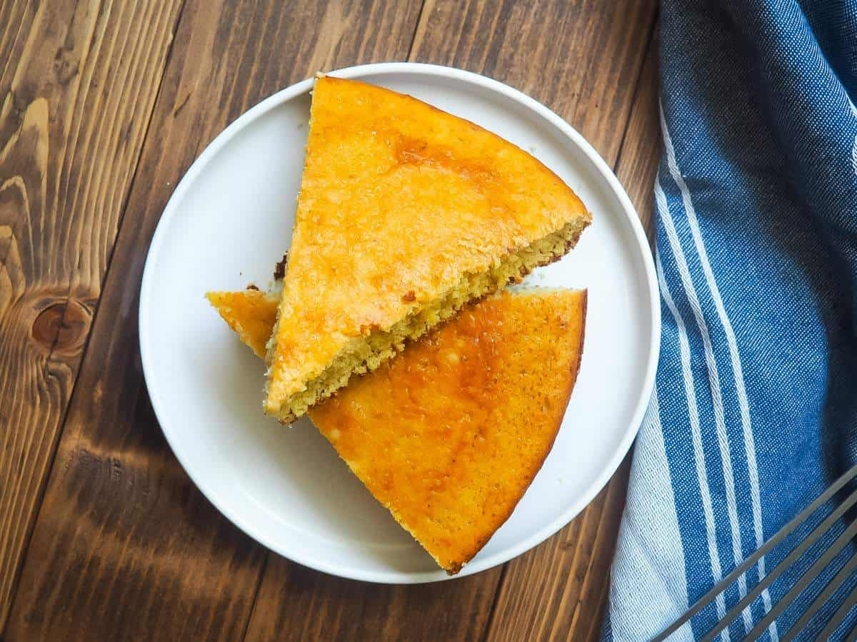 Slices of cornbread on a white plate.