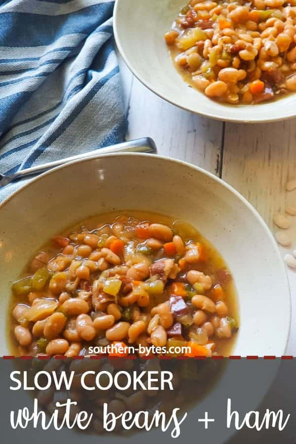 A pin image of two bowls of white beans and ham with a blue dish towel.