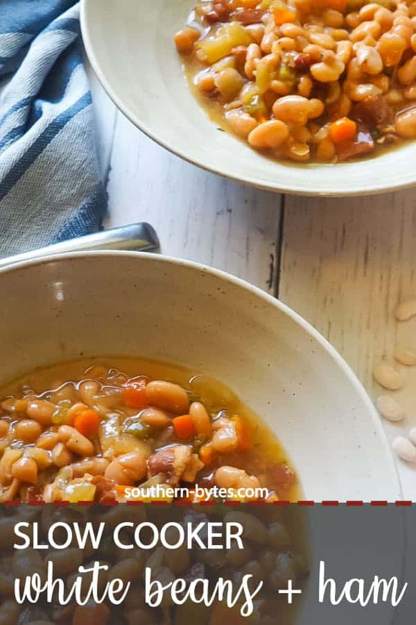 A pin image of two bowls of white beans and ham with Camellia beans spread around them.