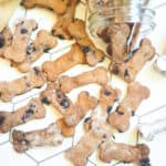 A pile of crunchy blueberry dog treats on a tile background.