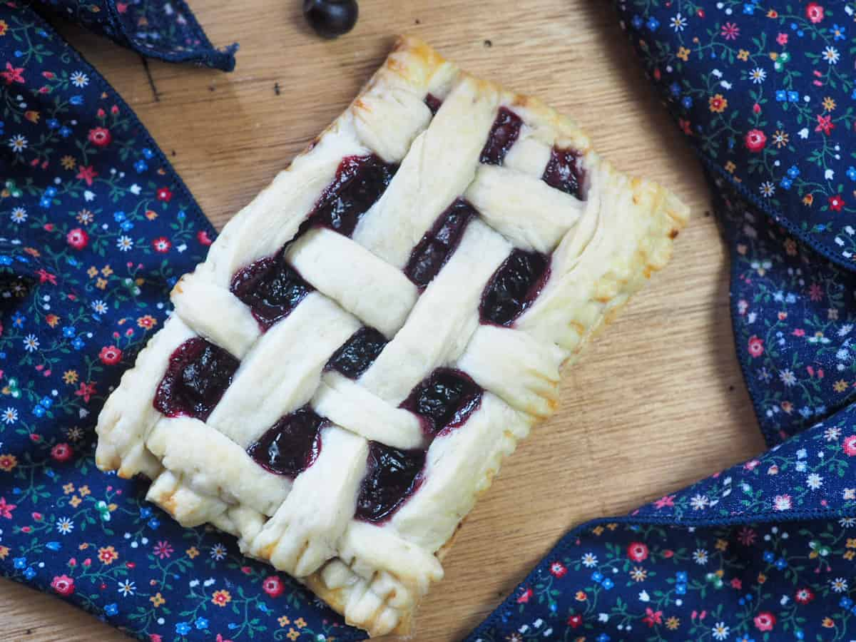 A homemade blueberry poptart with a lattice top.