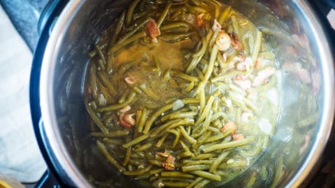 An Instant Pot with cooked southern green beans in it.