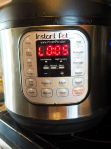 The front of an Instant Pot showing that it has been keeping warm for 5 minutes.