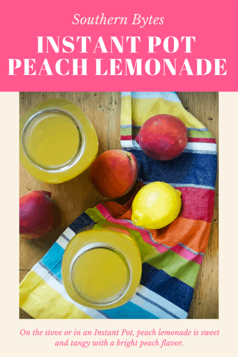 A pin image of two jars of peach lemonade on a wood board with peaches, a lemon, and a colorful placemat.