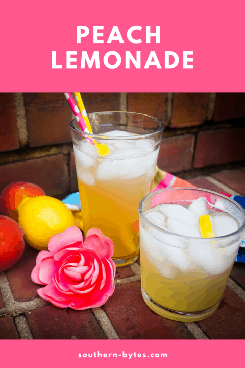 A pin image of two glasses of peach lemonade on brick steps with colored straws, peaches, a lemon, a pink flower, and lemon slices.