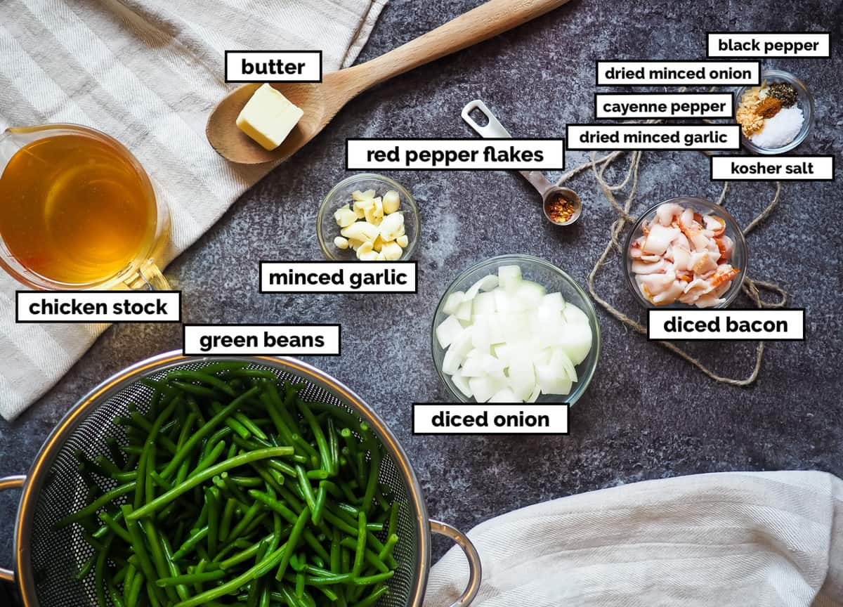 A picture of the ingredients of southern green beans on a gray background, labeled.