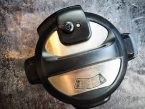 The top of an instant pot showing the sealed position.
