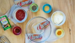 The ingredients in Raising Cane's sauce in small bowls.