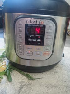 the front of an instant pot set to high pressure for 4 minutes