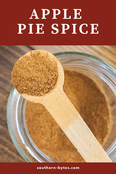 A pin image of a jar of apple pie spice with a small wooden spoon on top of the jar and text overlay.