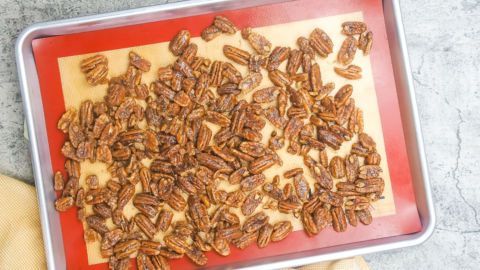 a tray of unbaked candied pecans.