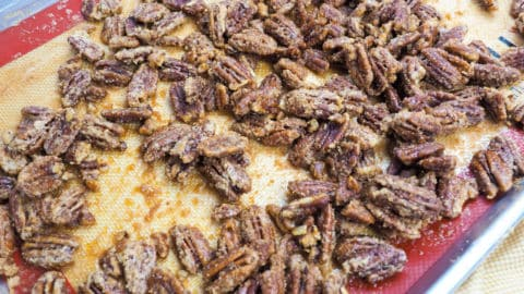 a zoomed in image of a tray of candied pecans.