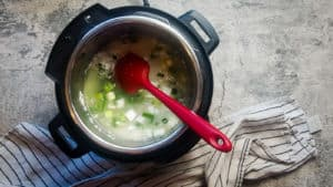 rice in broth cooking in an instant pot