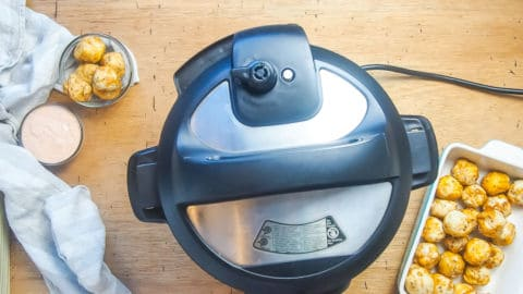 an instant pot full of pressure with the knob set to venting.