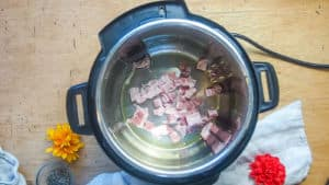 bacon and oil cooking in an instant pot.