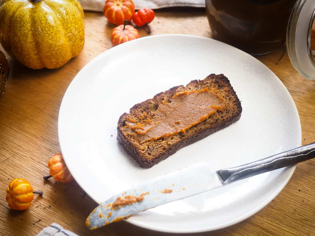 a slice of banana bread with pumpkin butter on it
