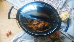 a covered crock pot with pumpkin butter in it