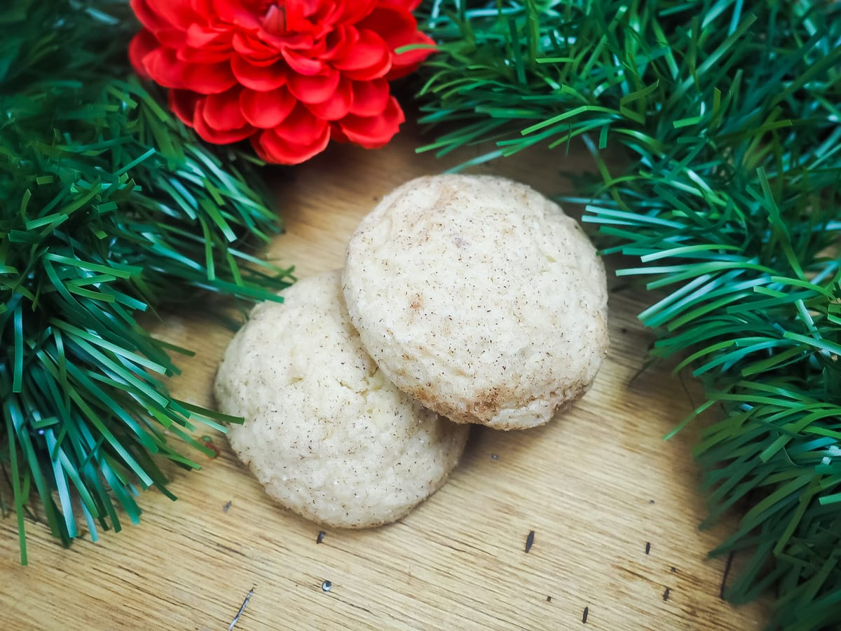 Two snickerdoodles surrounded by Christmas garland.