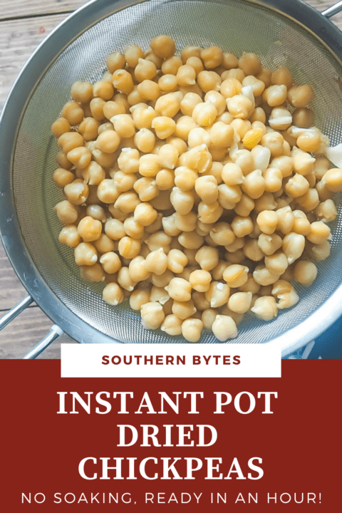 A pin image of cooked chickpeas in a metal strainer.