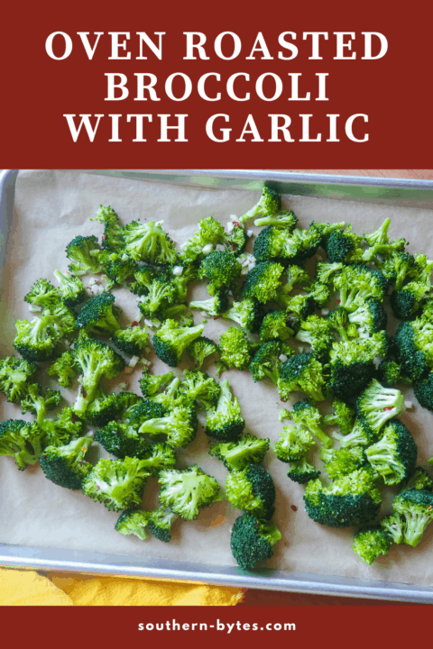 A pin image of a cookie sheet with broccoli and garlic on it before baking.