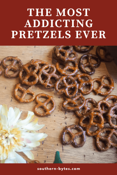 A pin image of seasoned pretzels spread out on a wooden board.