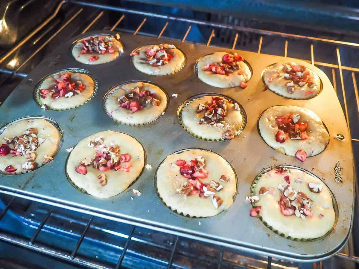 Cranberry, orange, and pecan muffins baking in the oven.