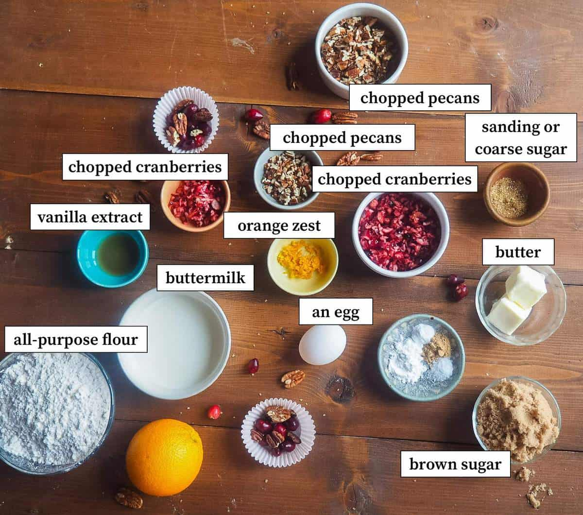 The ingredients in cranberry orange and pecan muffins laid out and labeled.