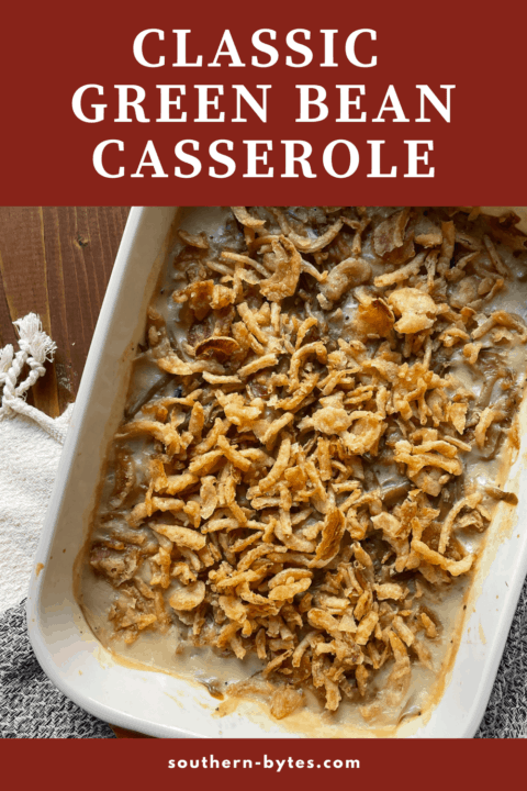 A pin image of green bean casserole covered in crispy onions in a baking dish.