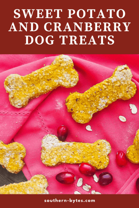 A pin image of bone shaped sweet potato and cranberry dog treats on a pink napkin.