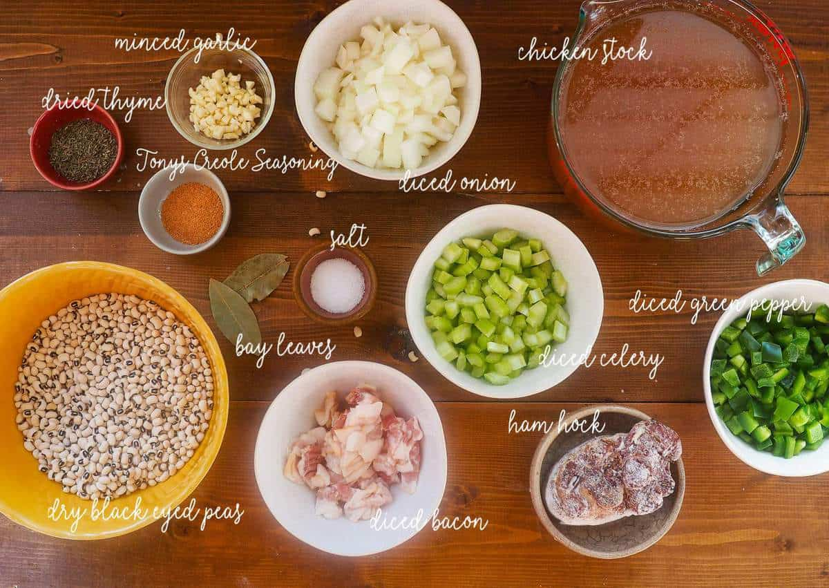 The ingredients in hoppin john laid out in small bowls and labeled.
