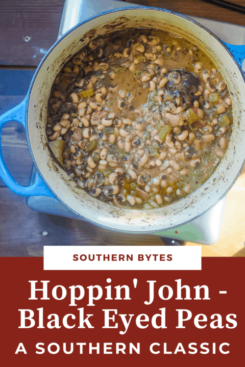 A pin image of a blue pot filled with cooked hoppin john black eyed peas.