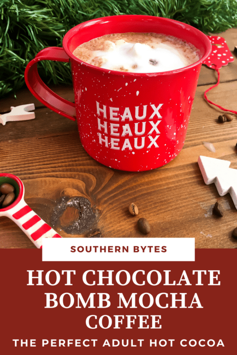 A pin image of a red mug of mocha hot cocoa with garland behind it.