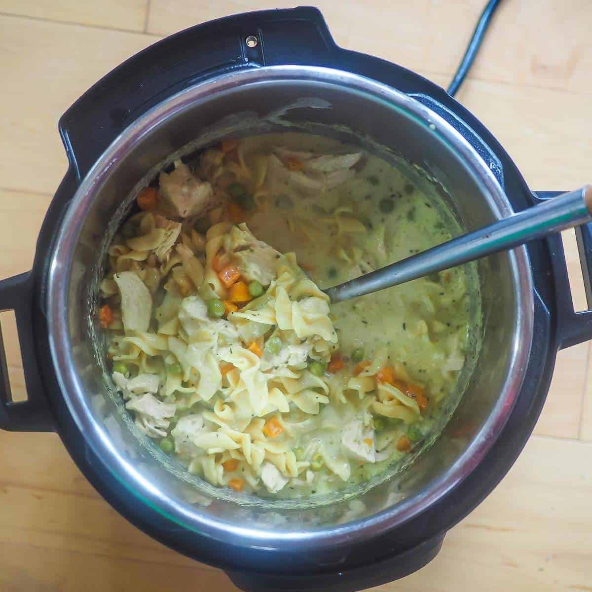 An instant pot of chicken pot pie soup.