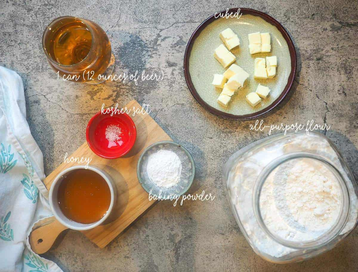 The ingredients in buttery beer bread laid out and labeled.