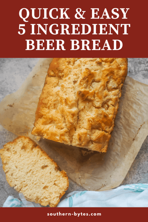 A pin image of a slice of beer bread on parchment next to the rest of the loaf.