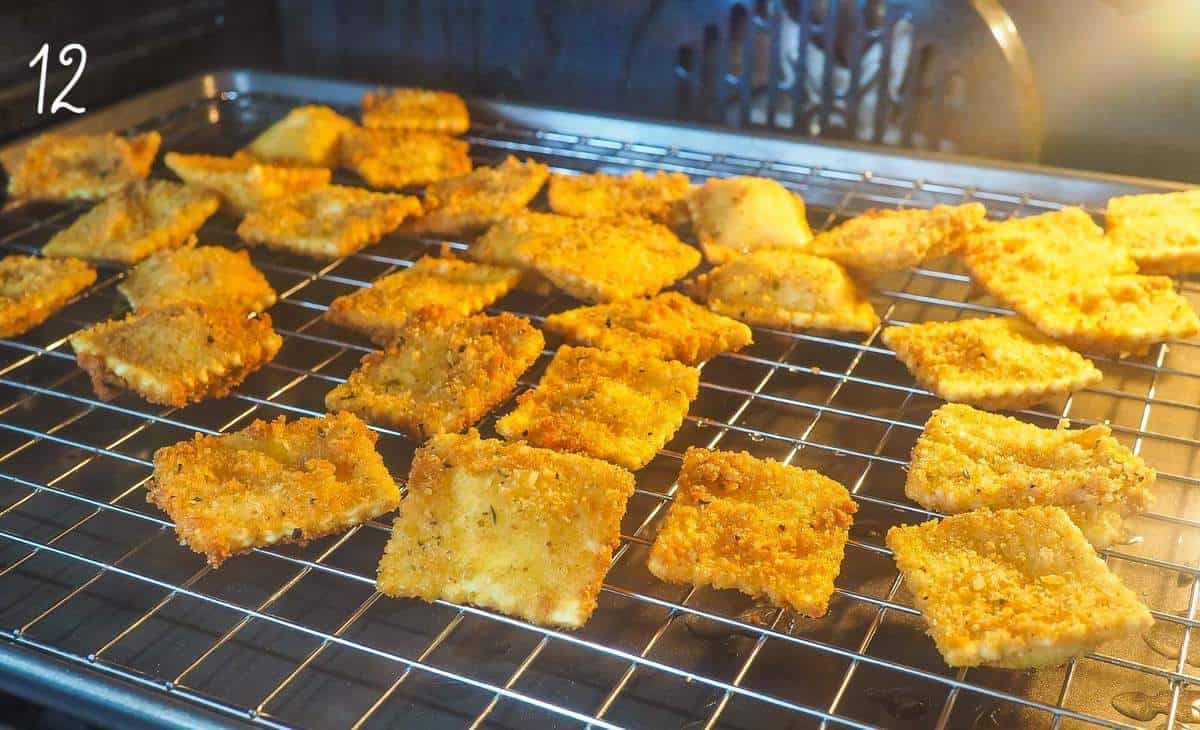 Fried ravioli on a cookie sheet in the oven.