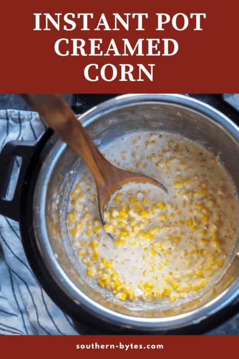 A pin image of a instant pot of creamed corn with a wooden spoon.